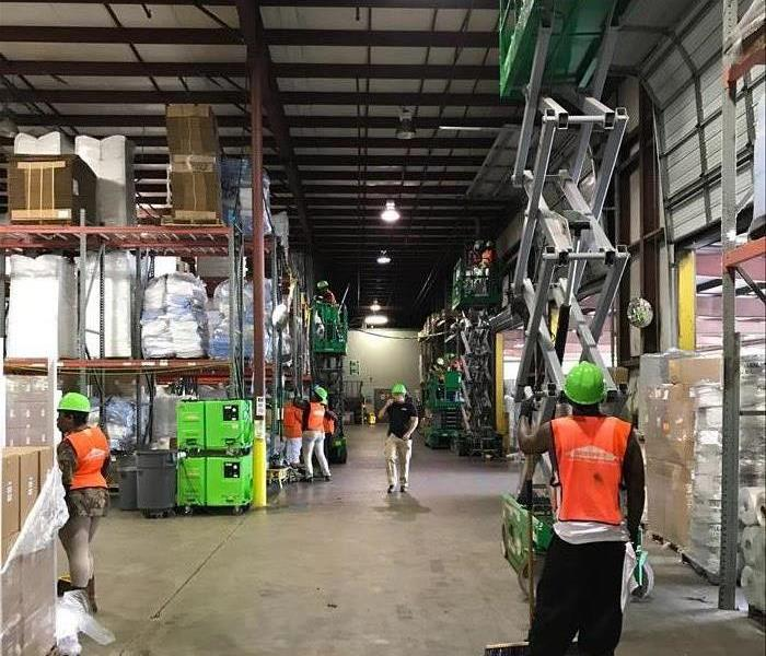 Cleaning up a large warehouse after a fire Before